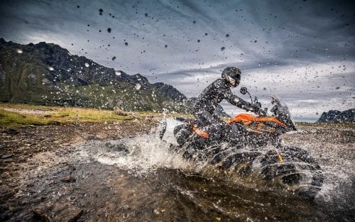 KTM rider on KTM motorcycle going through a river