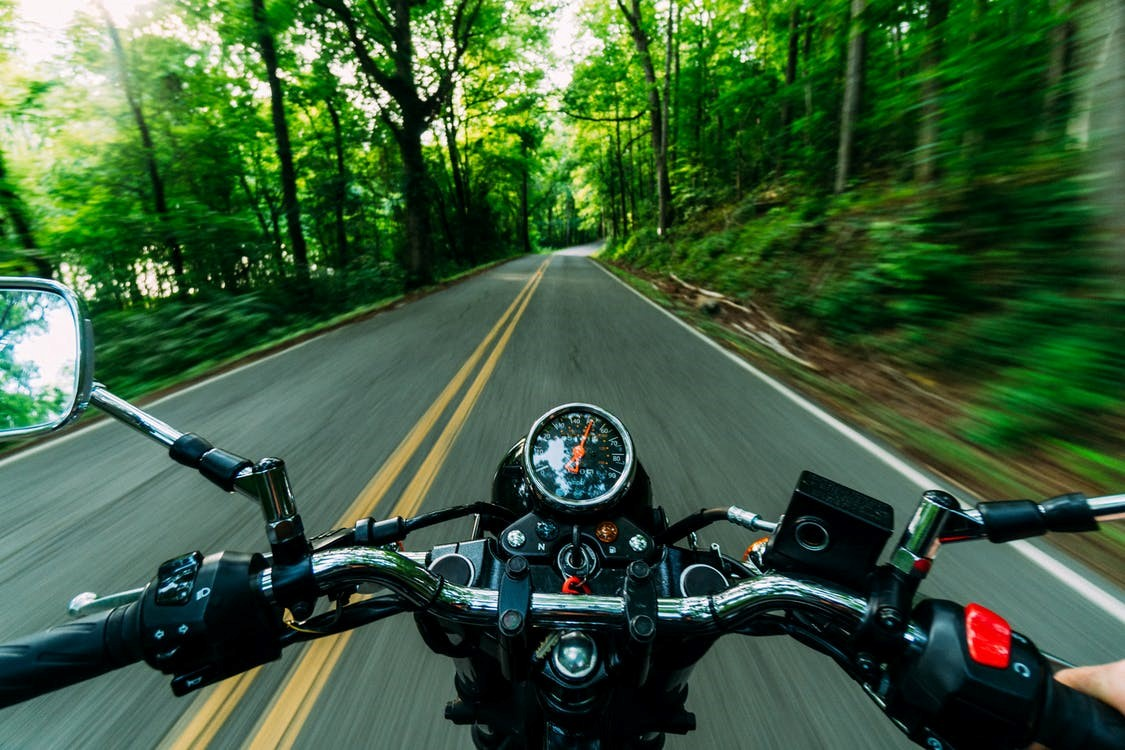 Motorcyle driving on road